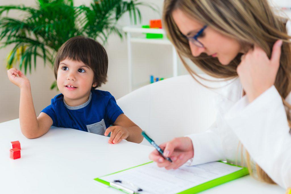Child psychology, little boy talking to psychologist
